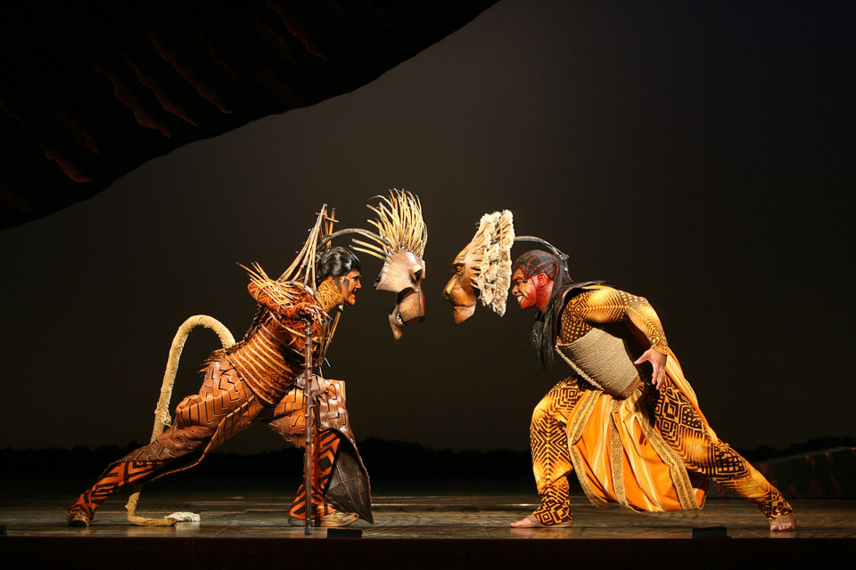 """Photo - Left: Timothy Carter as Scar, left, and Dionne Randolph as Mufasa face off in """"The Lion King"""" national tour, which is playing in Oklahoma City. On the tour, Chilean-born Francisco Trujillo is always on standby to play Scar if Carter cannot. Photo by Joan Marcus,  provided by Disney  ORG XMIT: 0905131640537606"""