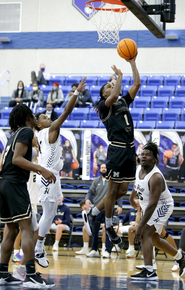 Photo - Midwest City's  Makale Smith shoot a basket during a high school boys basketball game between Midwest City and Heritage Hall during the Bruce Gray Invitational at Deer Creek High School in Oklahoma City, Okla., Friday, Jan. 22, 2021. Photo by Sarah Phipps, The Oklahoman