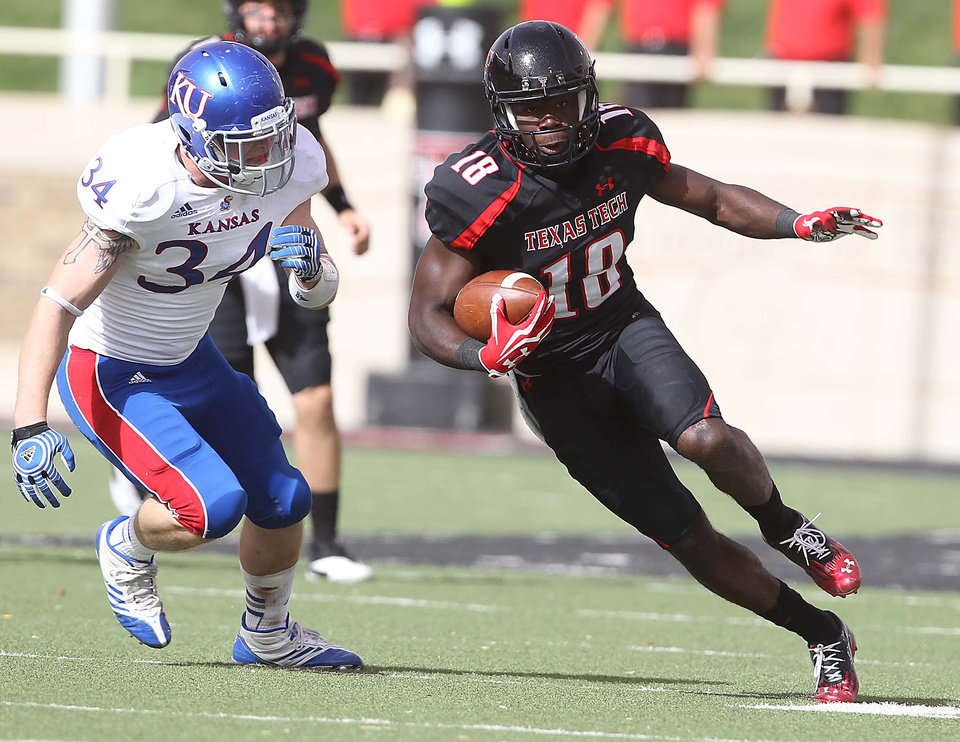 Texas Tech's Eric Ward (18) gets past Kansas' Huldon Tharp during their NCAA college football game in Lubbock, Texas, Saturday, Nov. 10, 2012. (AP Photo/Lubbock Avalanche-Journal, Zach Long) LOCAL TV OUT
