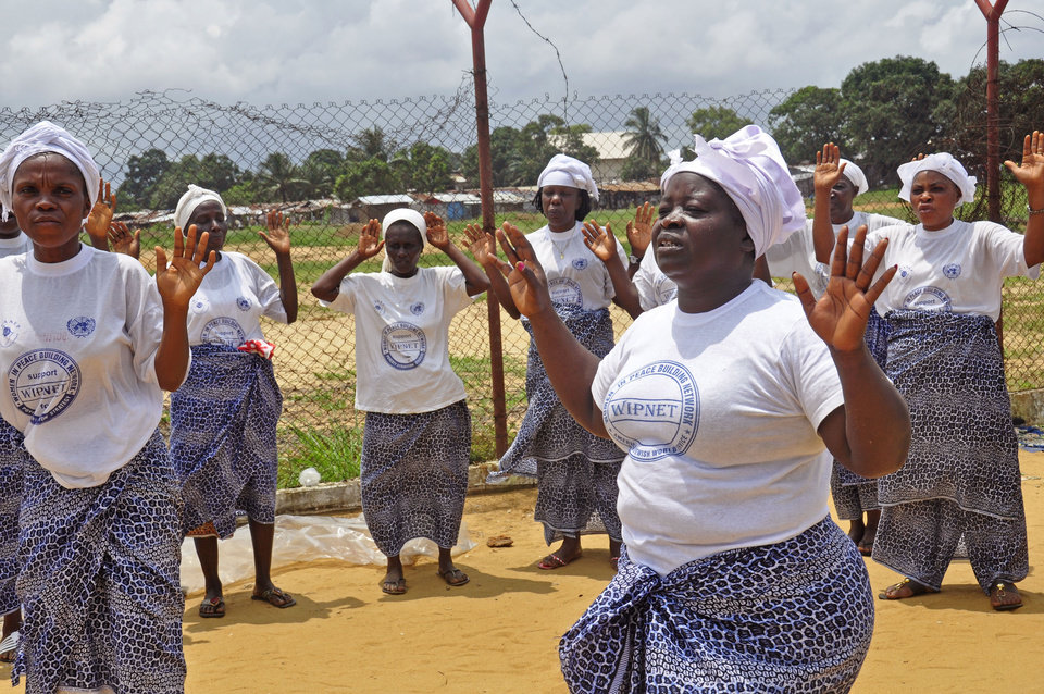 Photo - Women from different religious groups prey against the spread of the Ebola virus, in Monrovia, Liberia, Saturday Aug. 2, 2014. An Ebola outbreak that has killed more than 700 people in West Africa is moving faster than efforts to control the disease, the head of the World Health Organization warned as presidents from the affected countries met Friday in Guinea's capital. (AP Photo/Abbas Dulleh)