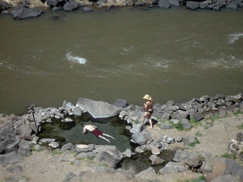 """Photo - This undated photo released by Lynn Pitcher Komer shows visitors at Stagecoach Hot Springs in New Mexico near Taos. The hot springs are a year-round favorite, dubbed """"hippie holes"""" by locals, and one of a number of free things to see and do in the Taos area. (AP Photo/Lynn Pitcher Komer)"""