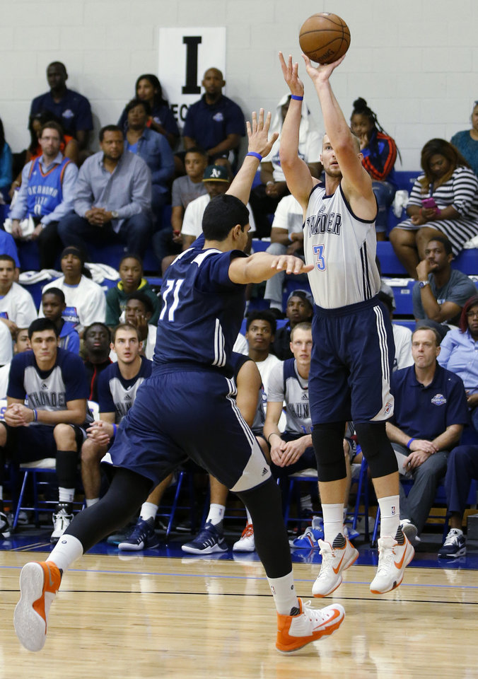 Photo - Oklahoma CIty's Domantas Sabonis shoots over Enes Kanter during the Thunder's annual Blue and White Scrimmage at John Marshall Mid-High School in Oklahoma City, Tuesday, Sept. 27, 2016. Photo by Bryan Terry, The Oklahoman