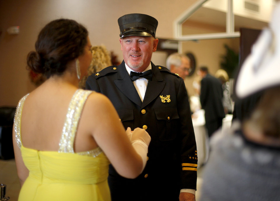 Photo - Portraying the first officer, Roger Ford greets guests as they enter the Titanic-theme fundraiser.