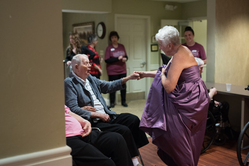 Photo -  Concordia resident Joan Quatro, right, dances in a ballgown with resident John Erickson before the facility's 10th anniversary gala. [PHOTO BY WHITNEY BRYEN, FOR THE OKLAHOMAN]