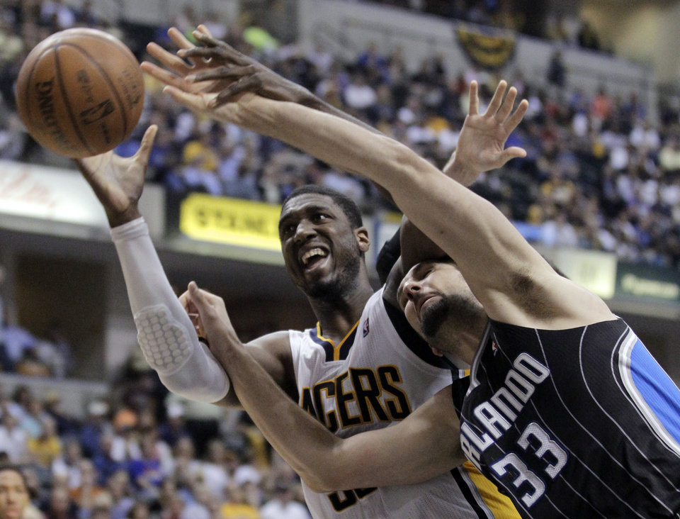 Photo -   Orlando Magic forward Ryan Anderson, right, and Indiana Pacers center Roy Hibbert go for a rebound during the second half of Game 5 of an NBA basketball first-round playoff series, in Indianapolis on Tuesday, May 8, 2012. The Pacers defeated the Magic 105-87 to win the series 4-1. (AP Photo/Michael Conroy)