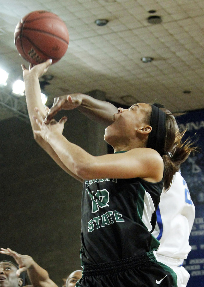 Photo - Wright State's Ivory James, left, shoots under pressure from Kentucky's Samarie Walker during the first half of a first-round game in the NCAA women's college basketball tournament in Lexington, Ky., Saturday, March 22, 2014. (AP Photo/James Crisp)
