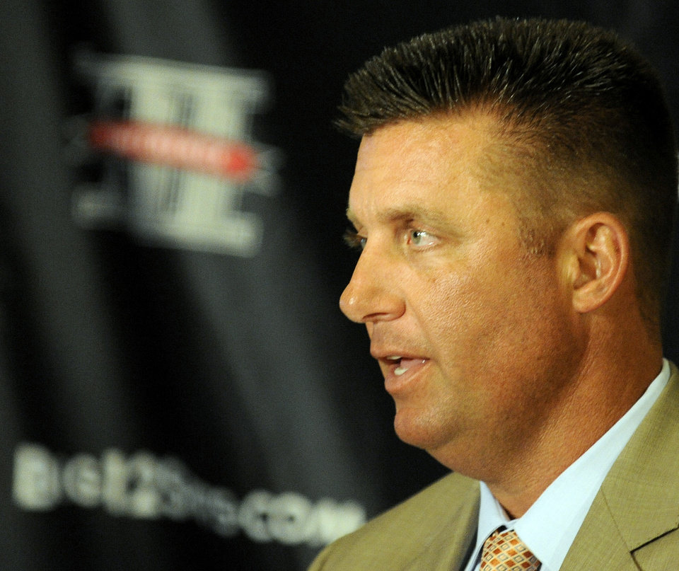 Photo - Oklahoma State head coach Mike Gundy speaks during the Big 12 Conference NCAA college football media days, Tuesday, July 24, 2012, in Dallas. (AP Photo/Matt Strasen)