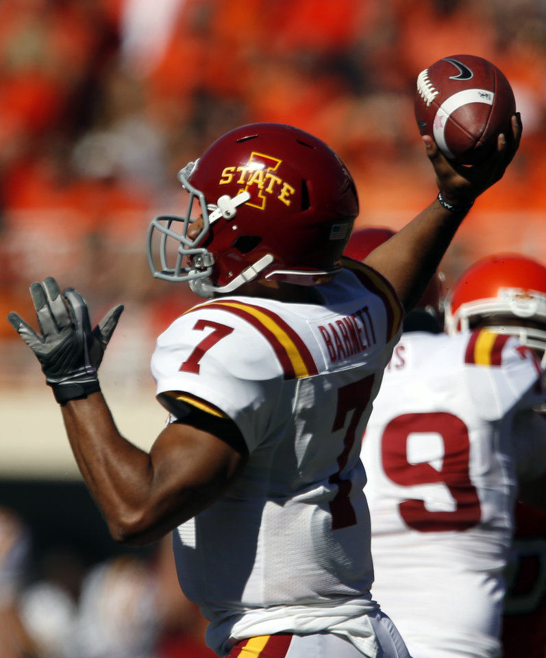 Photo - Iowa State's Jared Barnett (7) throws a pass during a college football game between Oklahoma State University (OSU) and Iowa State University (ISU) at Boone Pickens Stadium in Stillwater, Okla., Saturday, Oct. 20, 2012. Photo by Sarah Phipps, The Oklahoman