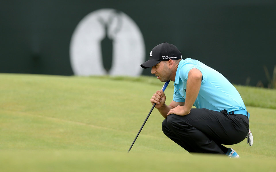 Photo - Sergio Garcia of Spain lines up a putt on the 1st green during the final round of the British Open Golf championship at the Royal Liverpool golf club, Hoylake, England, Sunday July 20, 2014. (AP Photo/Scott Heppell)