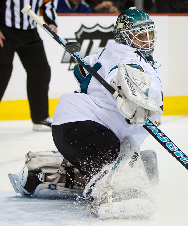 San Jose Sharks' goalie Antti Niemi, of Finland, makes a blocker save against the Vancouver Canucks during the first period of an NHL hockey game, Thursday, Nov. 14, 2013 in Vancouver, British Columbia.  (AP Photo/The Canadian Press, Darryl Dyck)