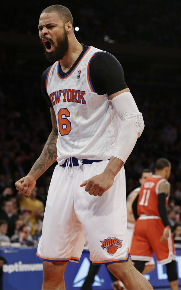 Photo - New York Knicks' Tyson Chandler (6) reacts after dunking the ball during the first half of an NBA basketball game against the Milwaukee Bucks, Friday, April 5, 2013, in New York. (AP Photo/Frank Franklin II)