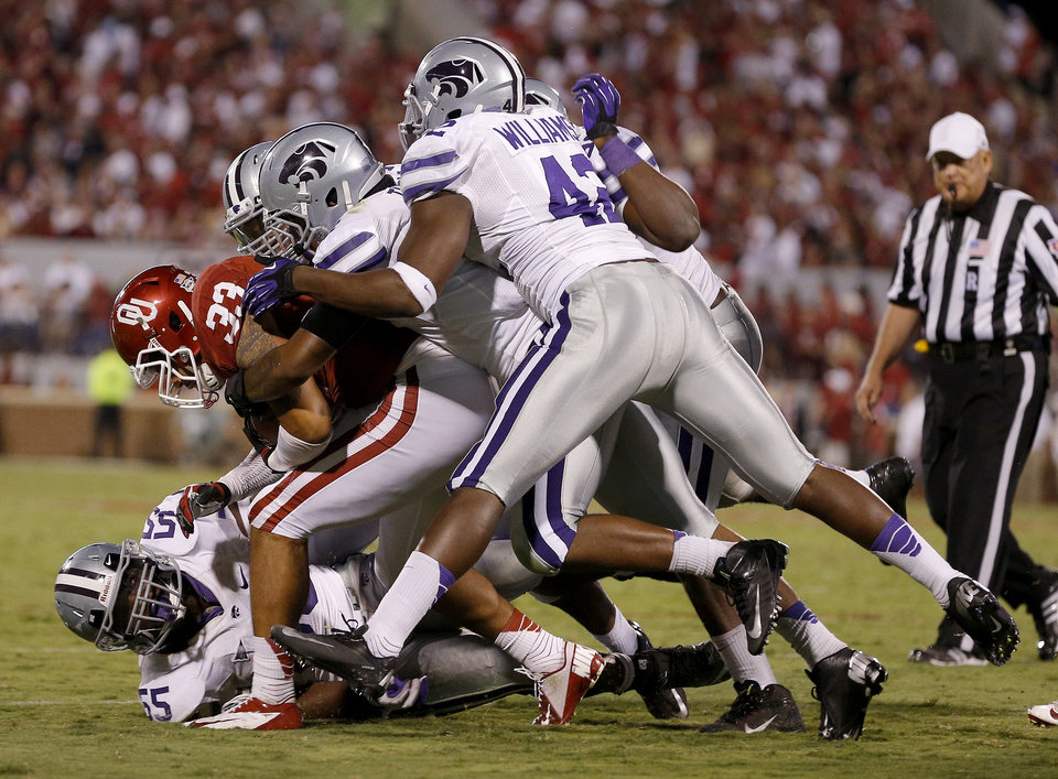 Photo - Oklahoma's Trey Millard (33) is brought down by a group of Kansas State defenders during a college football game between the University of Oklahoma Sooners (OU) and the Kansas State University Wildcats (KSU) at Gaylord Family-Oklahoma Memorial Stadium, Saturday, September 22, 2012. Oklahoma lost 24-19. Photo by Bryan Terry, The Oklahoman