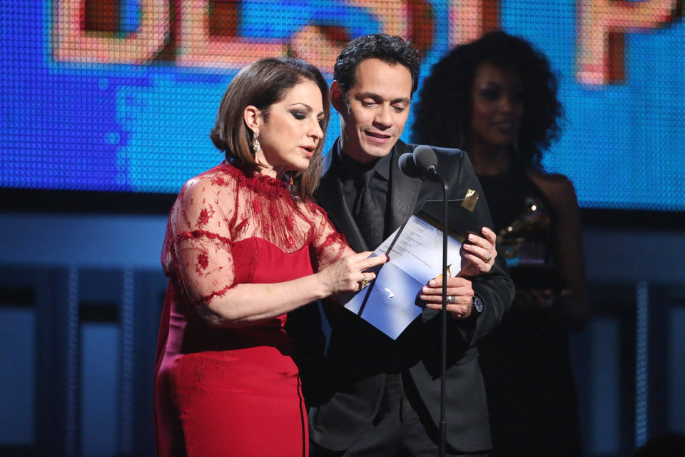 Photo - Gloria Estefan, left, and Marc Anthony present the award for best pop vocal album at the 56th annual Grammy Awards at Staples Center on Sunday, Jan. 26, 2014, in Los Angeles. (Photo by Matt Sayles/Invision/AP)