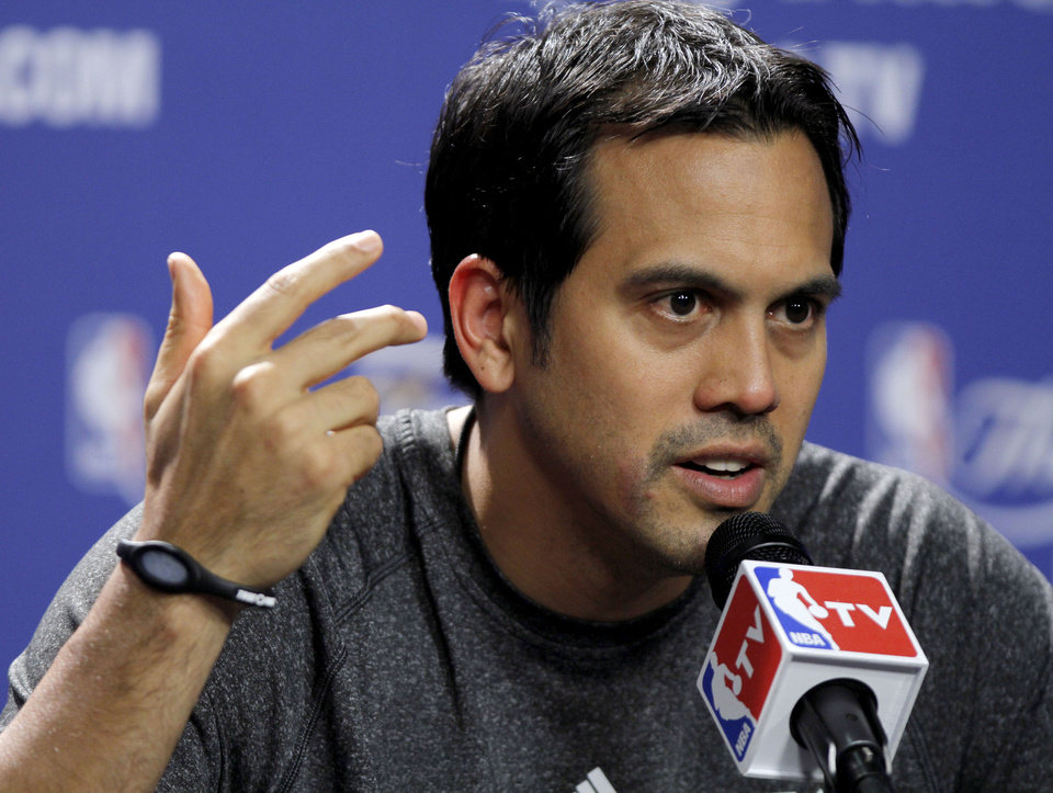 Photo - Miami coach Erik Spoelstra answers a question during a press conference for Game 3 of the NBA Finals between the Oklahoma City Thunder and the Miami Heat at American Airlines Arena in Miami, Saturday, June 16, 2012. Photo by Bryan Terry, The Oklahoman