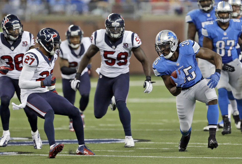 Photo -   Detroit Lions running back Joique Bell (35) runs around the defense of Houston Texans defensive back Quintin Demps (27), free safety Danieal Manning (38) and linebacker Whitney Mercilus (59) during the fourth quarter of an NFL football game at Ford Field in Detroit, Thursday, Nov. 22, 2012. (AP Photo/Paul Sancya)