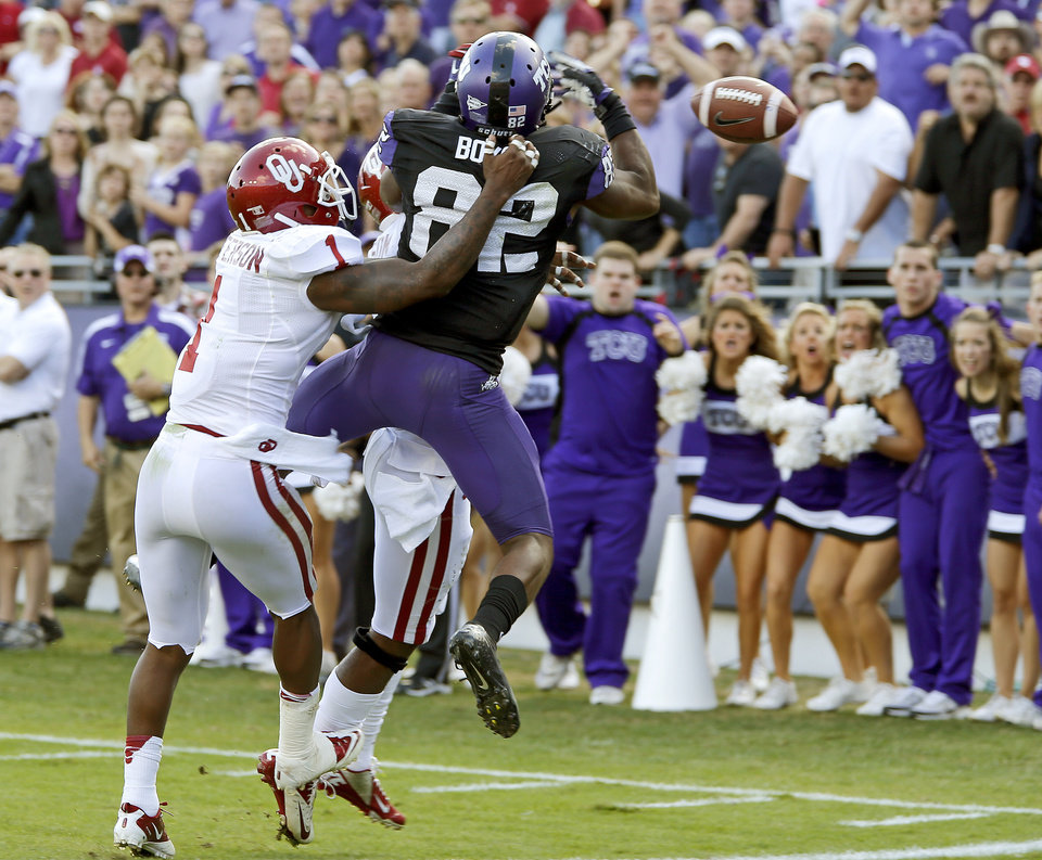 Oklahoma\'s Tony Jefferson (1) defends TCU\'s Josh Boyce (82) on a pass attempt in the final seconds of the college football game between the University of Oklahoma Sooners (OU) and the Texas Christian University Horned Frogs (TCU) at Amon G. Carter Stadium in Fort Worth, Texas, Saturday, Dec. 1, 2012. Oklahoma won 24-17. Photo by Bryan Terry, The Oklahoman