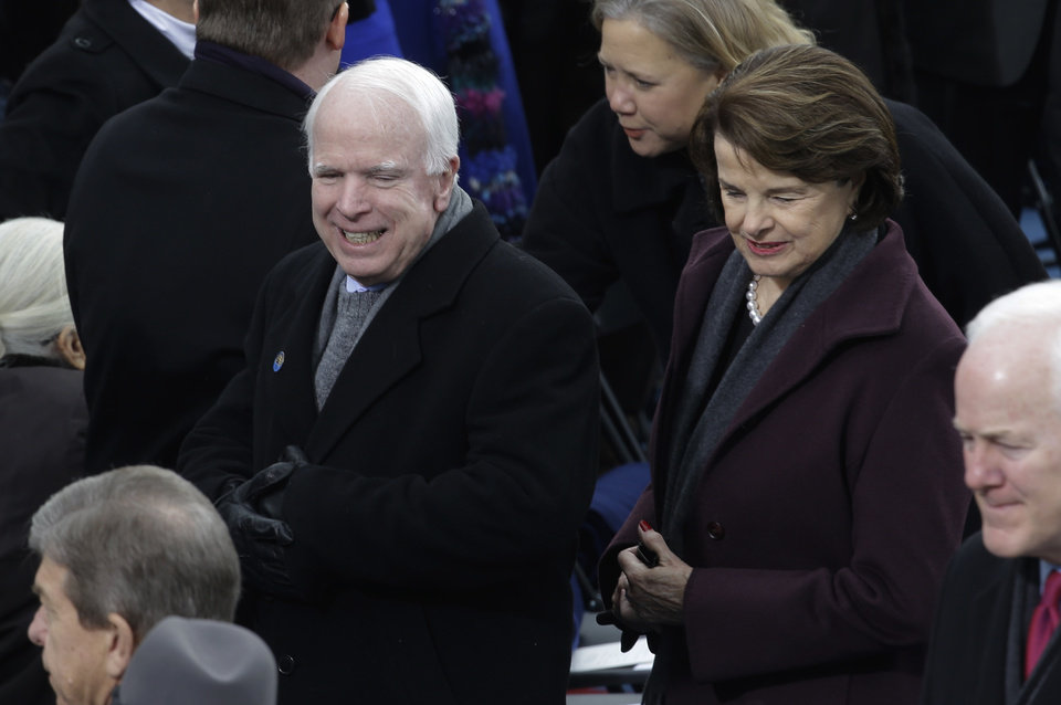 Photo - Sen. John McCain, R-Az., and Sen. Dianne Feinstein, D-Calif., arrive for the ceremonial of President Barack Obama swearing-in at the U.S. Capitol during the 57th Presidential Inauguration in Washington, Monday, Jan. 21, 2013. (AP Photo/Paul Sancya)