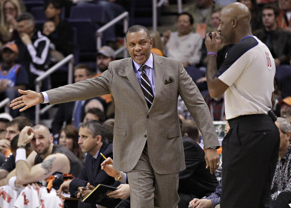 Phoenix Suns head coach Alvin Gentry, left, complains to referee Haywoode Workman, right, during the first half of an NBA basketball game against the New York Knicks, Wednesday, Dec. 26, 2012, in Phoenix. (AP Photo/Matt York)