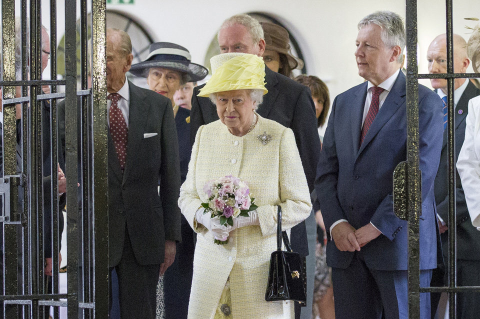 Photo - Britain's Queen Elizabeth II is seen  during a visit at the Crumlin Road jail visitor attraction in Belfast, Tuesday, June 24, 2014. The Queen will also visit the set of the Game of Thrones during her visit. (AP Photo/Paul Faith, pool)