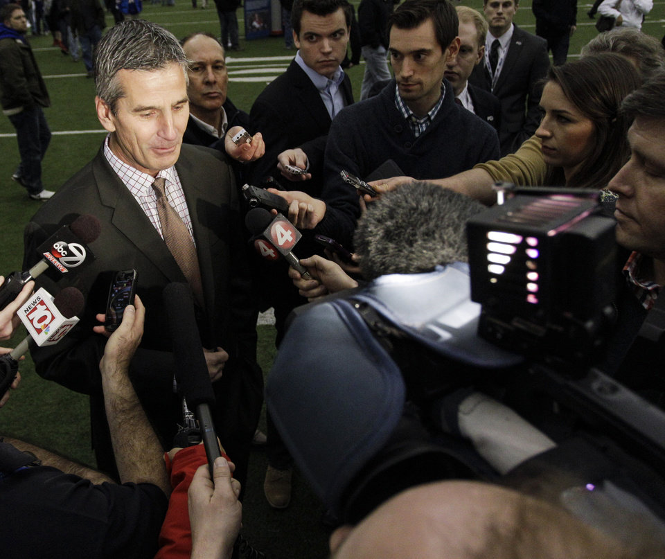 Photo - Former Buffalo Bills quarterback Frank Reich answers questions from the media during a public memorial and remembrance being held inside the NFL football team's fieldhouse for Buffalo Bills owner Ralph C. Wilson in Orchard Park, N.Y., Saturday, April 5, 2014. Wilson, the team's founder and sole owner, died March 25. (AP Photo/Nick LoVerde)