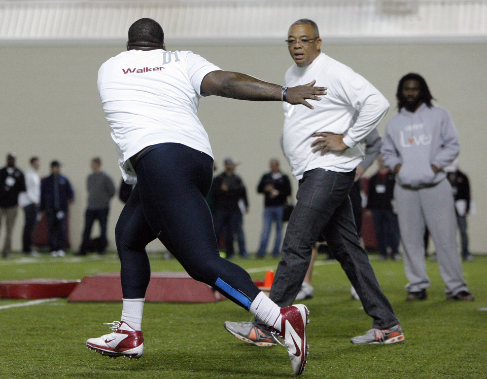 Photo - Casey Walker goes through drills with an NFL scout during Oklahoma Pro Day on the campus of the University of Oklahoma in Norman, Okla., Wednesday, March 13, 2013.  (AP Photo/Alonzo Adams)