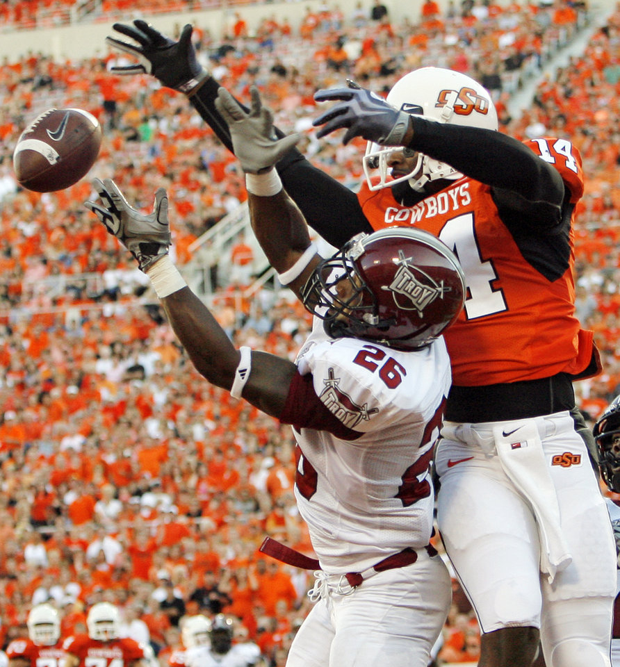 Photo - Troy's Bryan Willis (26) breaks up a pass in the endzone intended for Justin Horton (14) of OSU in the second quarter during the college football game between the Oklahoma State University Cowboys (OSU) and the Troy University Trojans at Boone Pickens Stadium in Stillwater, Okla., Saturday, Sept. 11, 2010. Photo by Nate Billings, The Oklahoman