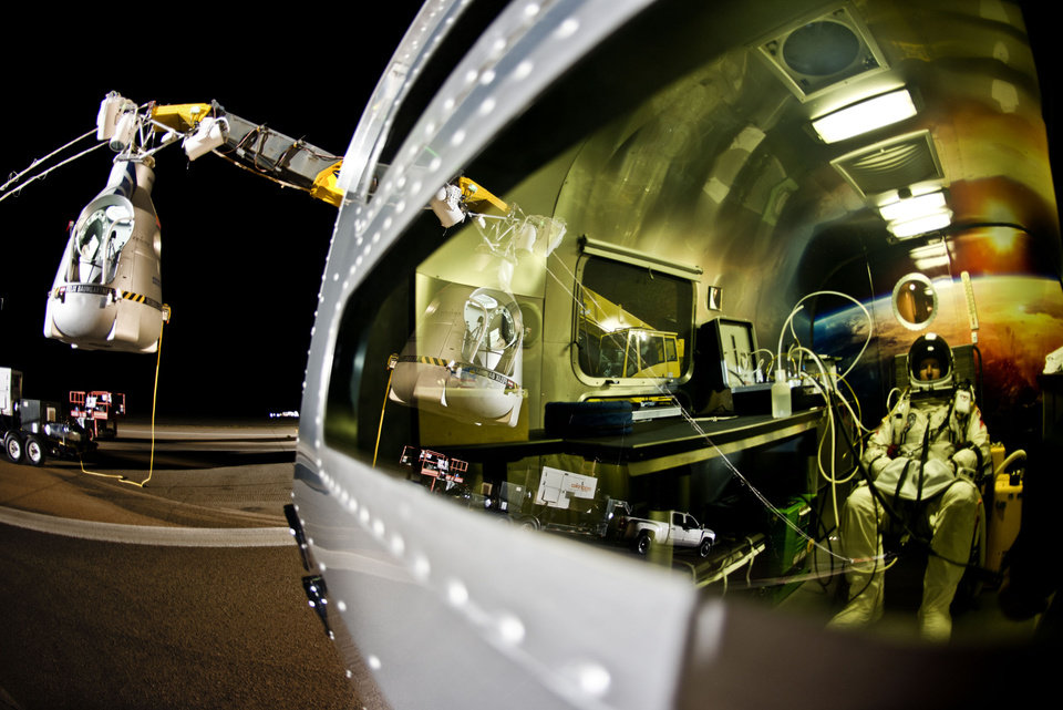 In this photo provided by Red Bull, pilot Felix Baumgartner of Austria sits in his trailer during the final manned flight for Red Bull Stratos in Roswell, N.M. on Sunday, Oct. 14, 2012. Baumgartner plans to jump from an altitude of 120,000 feet, an altitude chosen to enable him to achieve Mach 1 in free fall, which would deliver scientific data to the aerospace community about human survival from high altitudes.(AP Photo/Red Bull Stratos, Joerg Mitter) MANDATORY CREDIT ORG XMIT: NY202