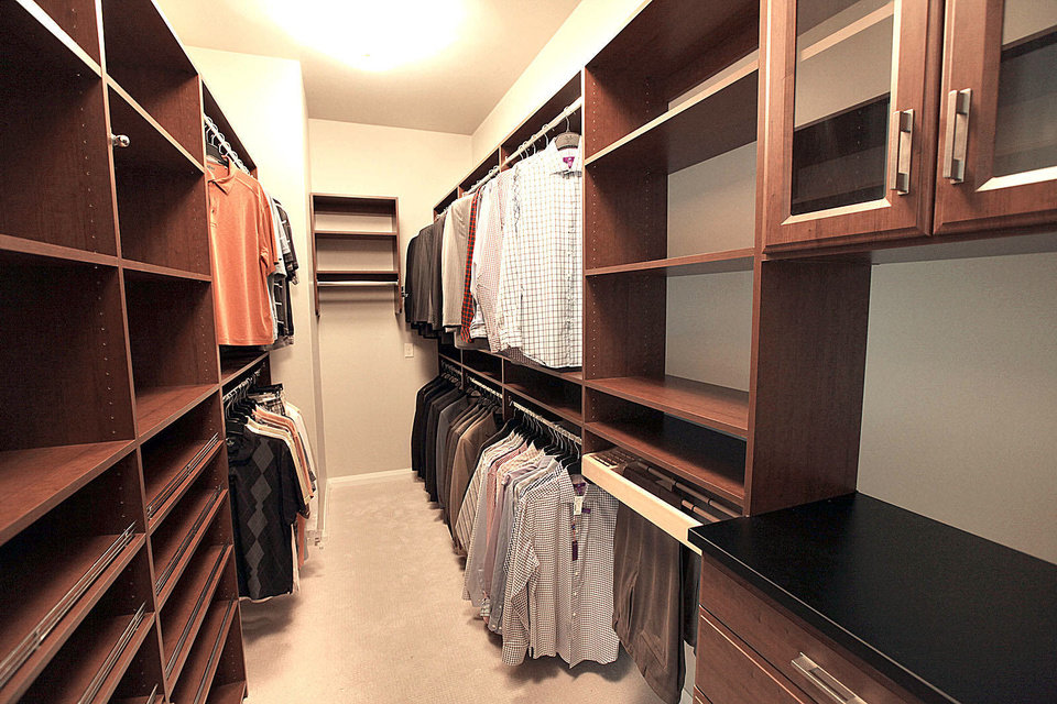 Photo - Built-ins add loads of function to a large closet at 1501 NW 158.  PAUL HELLSTERN - The Oklahoman