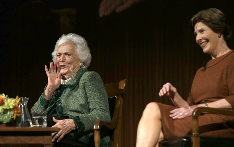 Former first ladies Barbara Bush, left, and Laura Bush speak during the Enduring Legacies of America�s First Ladies conference Thursday, Nov. 15, 2012, in Austin, Texas. Family members, former staff members, historians, and White House insiders also spoke as part of the program. (AP Photo/David J. Phillip)