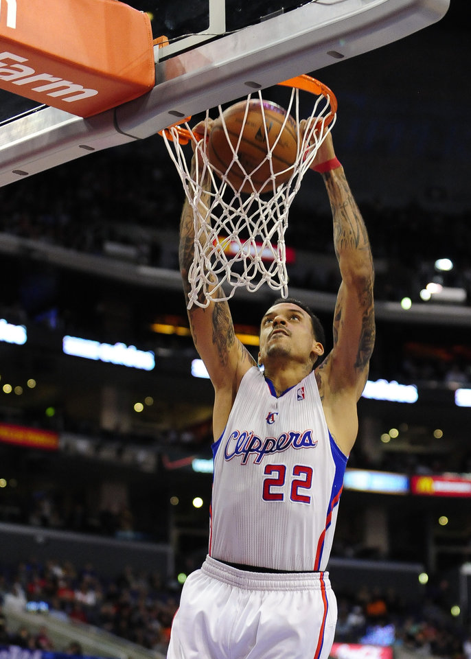 Photo - Los Angeles Clippers forward Matt Barnes dunks on a fast break in the first half of an NBA basketball game against the Atlanta Hawks, Saturday, March 8, 2014, in Los Angeles. (AP Photo/Gus Ruelas)