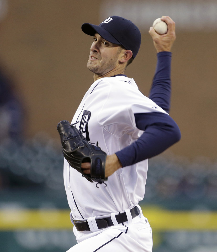 Photo - Detroit Tigers starting pitcher Rick Porcello throws during the first inning of a baseball game against the Minnesota Twins in Detroit, Thursday, May 23, 2013. (AP Photo/Carlos Osorio)