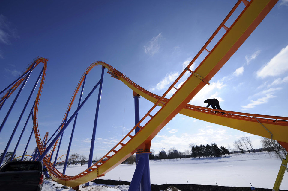 Photo - FILE - This Feb. 20, 2008 file photo shows Kevin Jones working on the construction of Behemoth, a roller coaster at Canada's Wonderland in Toronto. Once a regional amusement park chain, Cedar Fair Entertainment Co. has become an industry giant. It brought in 23.5 million visitors last year to its amusement and water parks, including Cedar Point and Kings Island in Ohio and Knott's Berry Farm near Los Angeles. (AP Photo/The Canadian Press, Kevin Van Paassen, The Globe and Mail, File) **TORONTO OUT, ONLINE OUT**