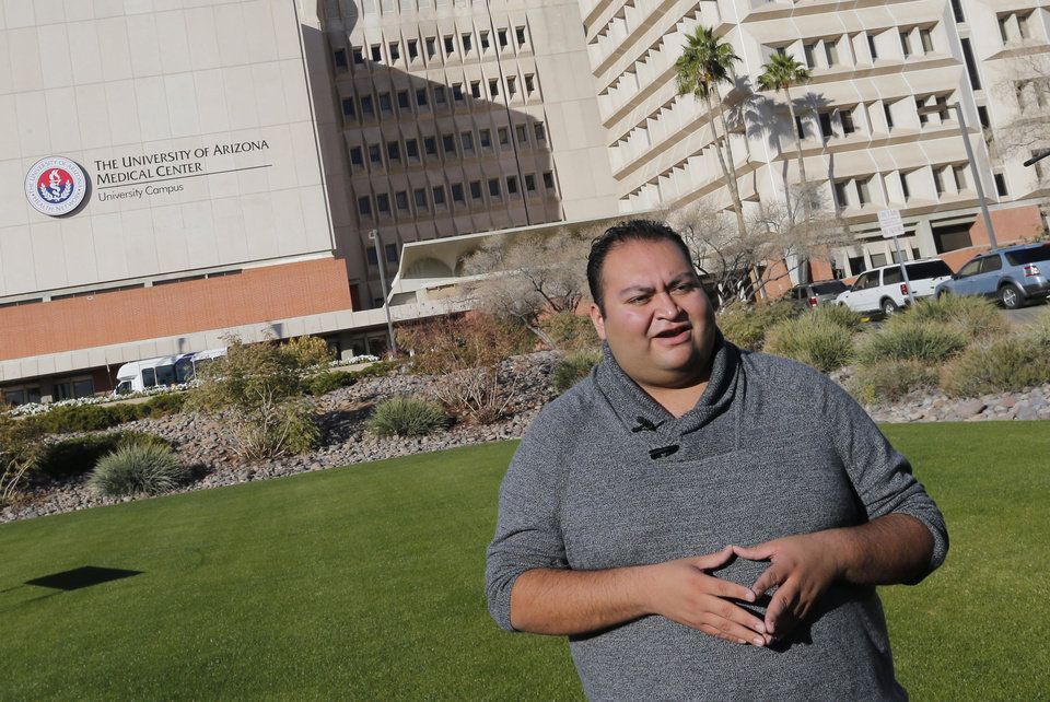 Photo - Daniel Hernandez Jr., a former intern for U.S Rep. Gabrielle Giffords, speaks prior to a remembrance ceremony on the third anniversary of the Tucson shootings, Wednesday, Jan. 8, 2014, in Tucson, Ariz. Six people were killed and 13 wounded, including Rep. Giffords, D-Ariz., in the shooting rampage at a community event hosted by Giffords in 2011. Hernandez attended to Giffords until paramedics arrived after the shooting.  Jared Lee Loughner was sentenced in November 2012 to seven consecutive life sentences, plus 140 years, after he pleaded guilty to 19 federal charges in the shooting. (AP Photo/Matt York)