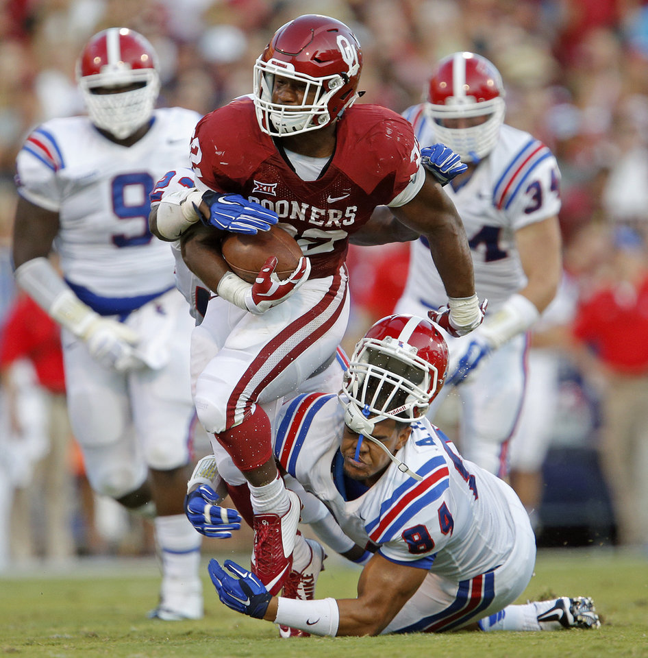 Photo - Oklahoma's Samaje Perine (32) runs past Louisiana Tech's Andre Taylor (84) during a college football game between the University of Oklahoma Sooners (OU) and the Louisiana Tech Bulldogs at Gaylord Family-Oklahoma Memorial Stadium in Norman, Okla., on Saturday, Aug. 30, 2014. Photo by Bryan Terry, The Oklahoman