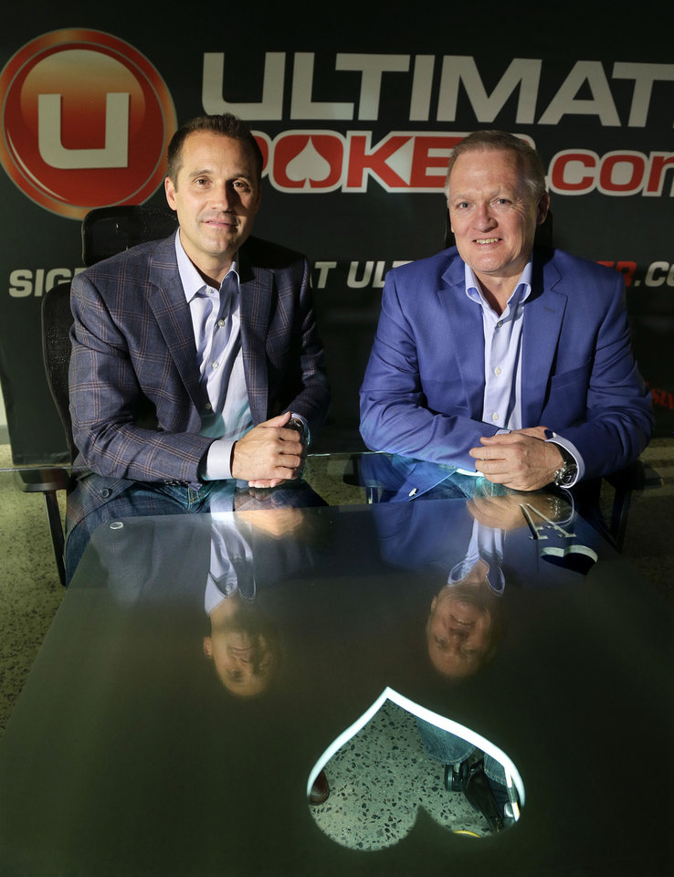 Ultimate Gaming chairman Tom Breitling, left, and CEO Tobin Prior sit for a photo at their company headquarters, Monday, April 29, 2013, in Las Vegas. The social gaming company is expected to launch the first legal, real-money poker site in the U.S. Tuesday morning. The Ultimate Gaming site will be available only to in players in Nevada, but likely represents the shape of things to come for gamblers across the country. (AP Photo/Julie Jacobson)