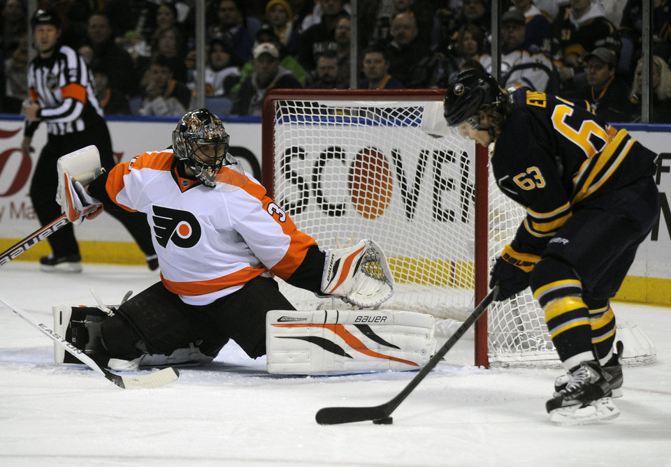 Philadelphia Flyers goaltender Ilya Bryzgalov, of Russia, gets ready for a shot by Buffalo Sabres'  left winger Tyler Ennis during the first period of an NHL season opener hockey game in Buffalo, N.Y., Sunday, Jan. 20, 2013. (AP Photo/Gary Wiepert)