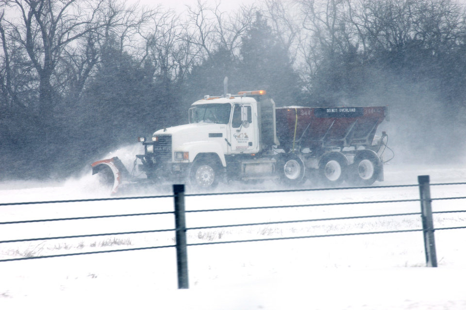Photo - A snow plow makes its way east on I-44 during a major winter storm that hit central Oklahoma Tuesday, Feb. 1, 2011. Photo by Doug Hoke, The Oklahoman.