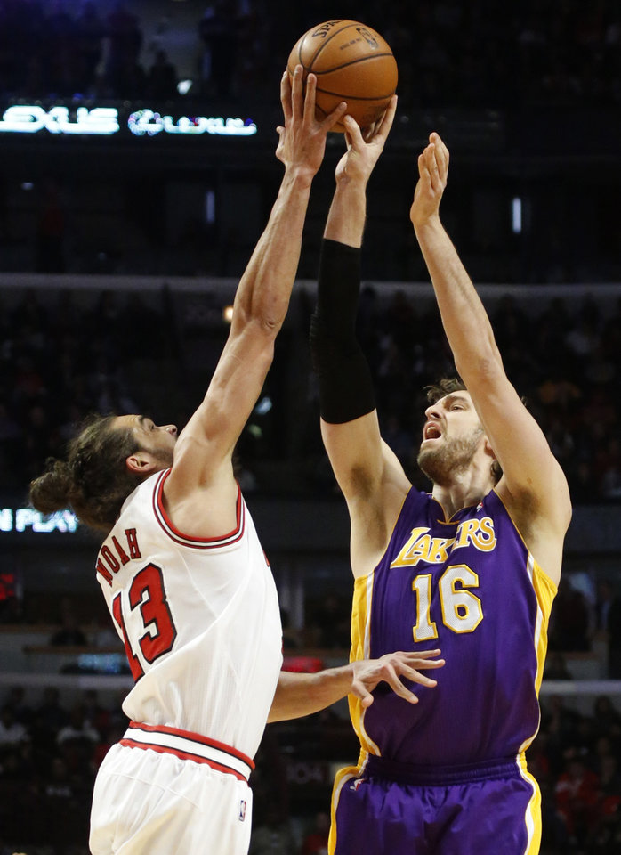 Chicago Bulls center Joakim Noah (13) blocks the shot of Los Angeles Lakers forward Pau Gasol during the first half of an NBA basketball game, Monday, Jan. 21, 2013, in Chicago. (AP Photo/Charles Rex Arbogast)