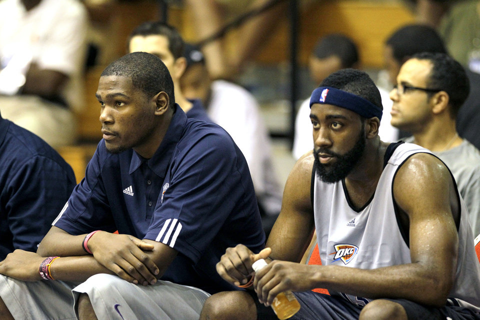 Photo - THE TEAMMATE :  On the day before he announced his five-year contract extension with the Oklahoma City Thunder on Twitter, Kevin Durant was the only active NBA scoring champ sitting on the bench at the Orlando Summer League. Shown here with James Harden, Durant has showed up at summer league every year since joining the league. Twice he's played, twice he's shown up to support teammates.