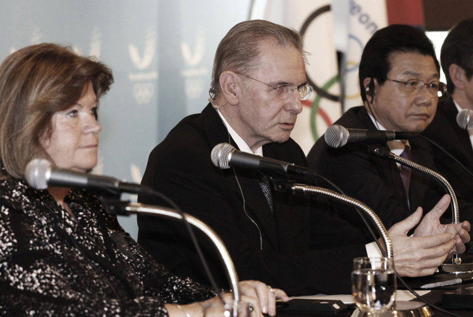 Photo - International Olympic Committee (IOC) President Jacques Rogge, center, speaks as Kim Jin-sun, head of the Pyeongchang Organizing Committee for the 2018 Winter Olympics, and Gunilla Lindberg, a chair of IOC Evaluation Commission, left, listen during a press conference in Seoul, South Korea, Friday, Feb. 1, 2013. Rogge arrived in South Korea on Wednesday for a four-day visit to inspect ongoing preparations for the 2018 Pyeongchang Olympic Winter Games in the South Korean alpine city. (AP Photo/Ahn Young-joon)