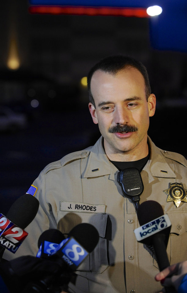 Photo - CORRECTS LOCATION OF MALL - Clackamas County sheriff's Lt. James Rhodes speaks to the media outside the scene of a multiple shooting at Clackamas Town Center Mall in Portland, Ore., Tuesday Dec. 11, 2012. A gunman is dead after opening fire in the Portland, Ore., area shopping mall Tuesday, killing two people and wounding another, sheriff's deputies said. (AP Photo/Greg Wahl-Stephens)
