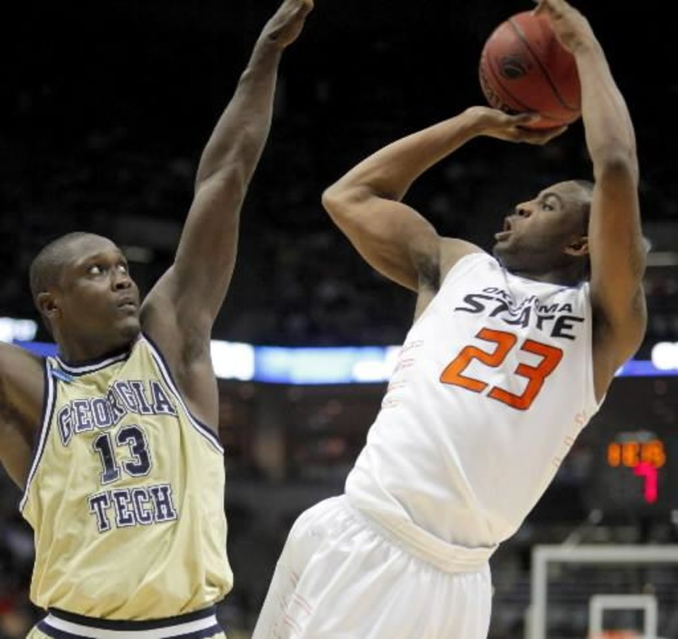 OSU's  James  Anderson is fouled by Georgia Tech's D'Andre Bell during the first round of the NCAA men's basketball tournament between Oklahoma State University and Georgia Tech at the Bradley Center in Milwaukee, Friday, March 19, 2010. Photo by Bryan Terry