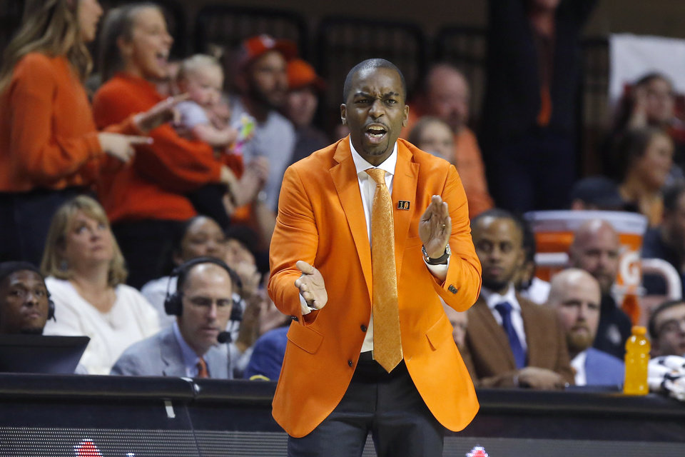 Photo - Oklahoma State coach Mike Boynton claps during an NCAA men's Bedlam basketball game between the Oklahoma State University Cowboys (OSU) and the University of Oklahoma Sooners (OU) at Gallagher-Iba Arena in Stillwater, Okla., Saturday, Feb. 22, 2020. Oklahoma State won 83-66. [Bryan Terry/The Oklahoman]