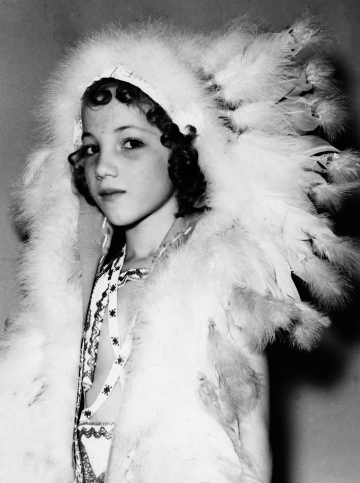 Photo - Photo of Oklahoma City dancer Yvonne Chouteau, age 7, dressed as an American Indian. Staff photo by G.R. Allred, taken 11/30/36.
