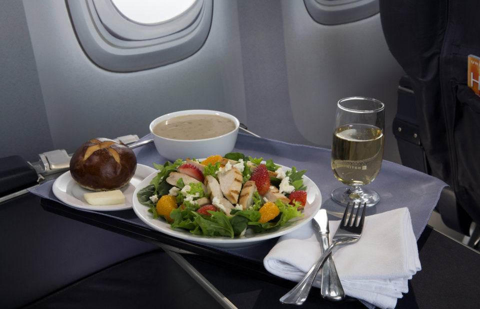 Photo - This product image provided by United Airlines shows a Strawberry Fields Salad, one of a variety of the airline's new first class food options.  The Chicago-based airline on Thursday, Aug. 21, 2014 announced that it's upgrading first class food options and replacing snacks with full meals on some of its shortest flights. (AP Photo/United Airlines)