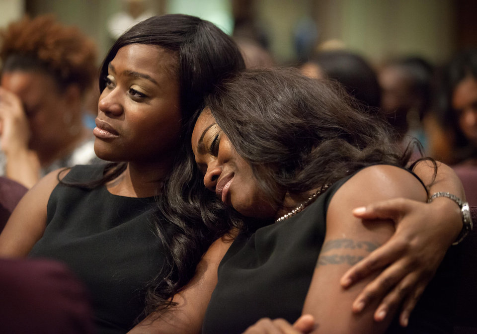 Photo - Jennifer Humphrey, right, is comforted by her sister Jeanine Humphrey as they attend the funeral service for Chris Kelly of the rap duo Kris Kross, Thursday, May 9, 2013, in Atlanta. The 34-year-old Kelly was found dead May 1 of a suspected drug overdose. Kriss Kross, the rap duo of Kelly and Chris Smith, was introduced to the music world in 1992 by music producer and rapper Jermaine Dupri after he discovered the pair at a mall in southwest Atlanta. (AP Photo/David Goldman)