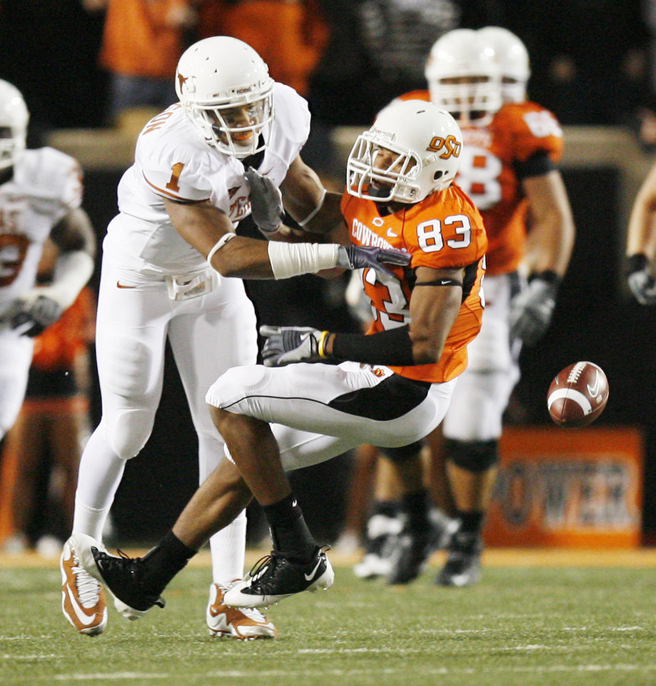 Photo - Texas' Keenan Robinson (1) breaks up a pass intended for OSU's Dameron Fooks (83) during the college football game between the Oklahoma State University Cowboys (OSU) and the University of Texas Longhorns (UT) at Boone Pickens Stadium in Stillwater, Okla., Saturday, Oct. 31, 2009. Photo by Sarah Phipps, The Oklahoman