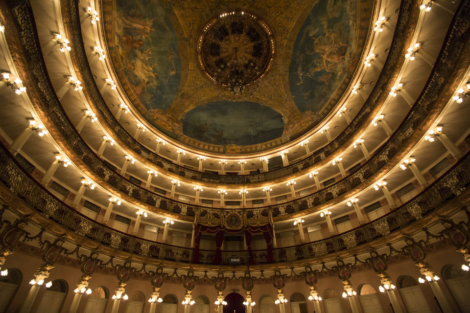 Photo - This May 20, 2014 photo, shows an interior view of the Teatro Amazonas in Manaus, Brazil. Inside the theater, the familiar chords of signature arias resound among elaborate woodwork and Murano chandeliers. Only the finest materials were used in the construction of the opera house - marble and Murano glass ferried in from Italy, steel from Britain and bronze from Belgium. (AP Photo/Felipe Dana)