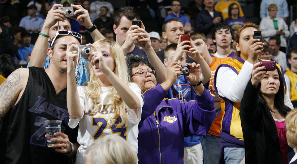 Fans try to get photos of the Lakers warming up before the NBA basketball game between the Los Angeles Lakers and the Oklahoma City Thunder at the Ford Center in Oklahoma City, Friday, March 26, 2010. Photo by Nate Billings, The Oklahoman