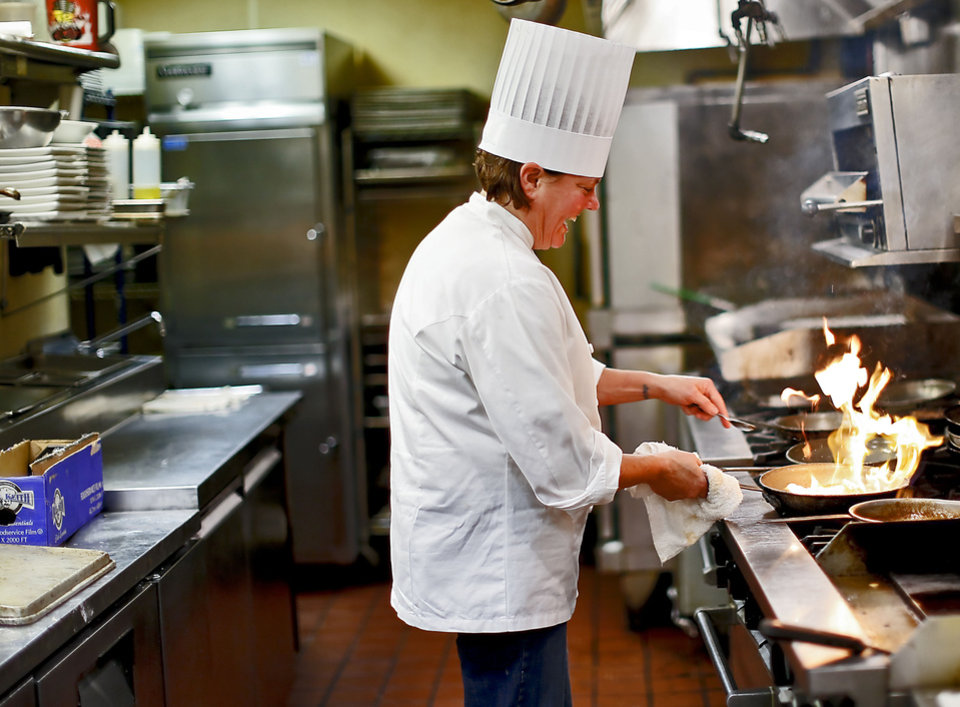 Chef Christine Dowd works in the kitchen at The Metro Wine Bar and Bistro, where she is the new executive chef. <strong>CHRIS LANDSBERGER - THE OKLAHOMAN</strong>
